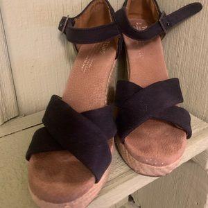 Black canvas strap  wedge shoes.